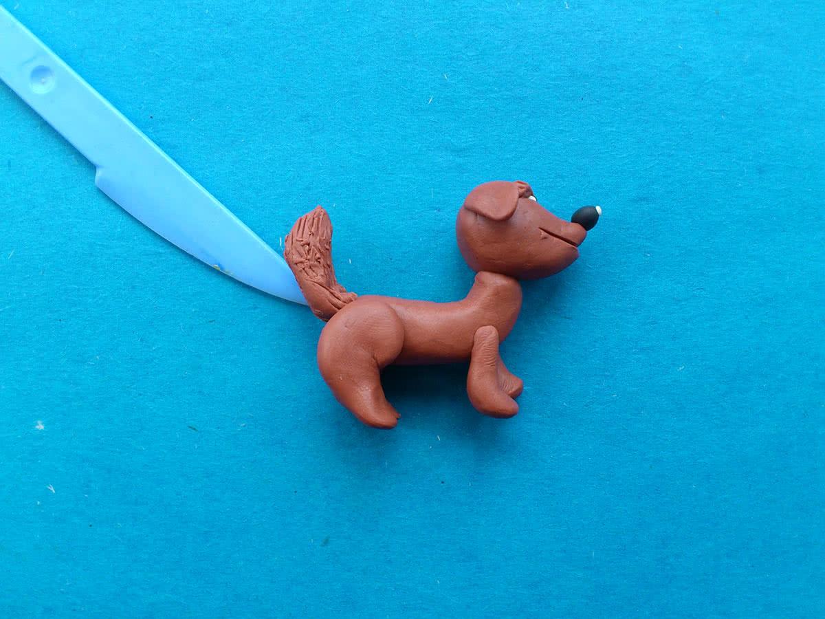готовая собака из пластилина